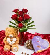 Seven roses and teddy bear